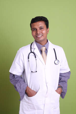 Indian young doctor posing to the camera. Stock Photo - 12176548