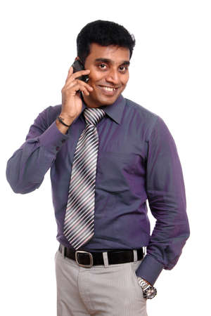 Indian young businessman talking in mobile phone photo