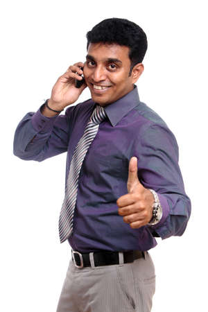 calling businessman: Indian young businessman talking in mobile phone