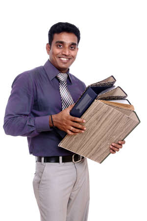 thirty���s: Indian young businessman posing with documents Stock Photo