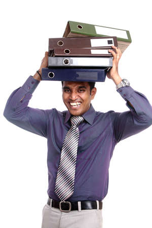 hard worker: Indian young businessman posing with documents Stock Photo