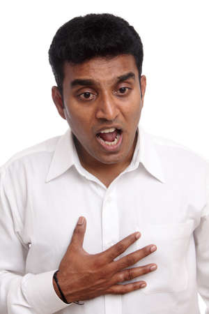 Indian young businessman getting heart pain photo