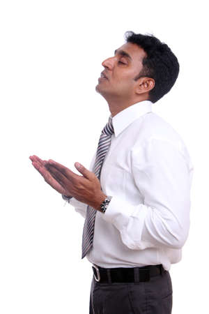 thirty���s: Praying young Indian businessman Stock Photo