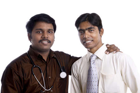 Two Indian young doctors posing to the camera.  Stock Photo - 12223231
