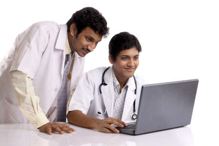 Two Indian young doctors posing to the camera.  Stock Photo