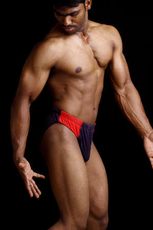 asian bodybuilder: Indian young fitness man posing to the camera.  Stock Photo