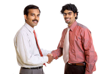 Two Indian business people shaking hands  photo