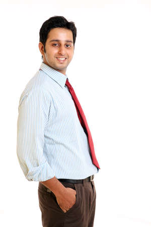 Smiling Indian young businessman on white.