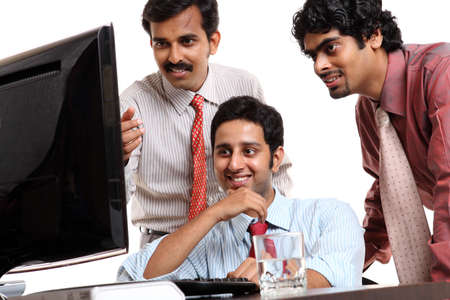 Indian young business people in office isolated on white Stock Photo - 12223702