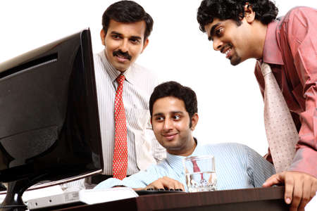knowledgeable: Indian young business people in office isolated on white