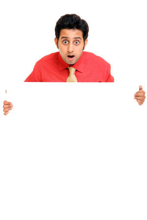 Confident Indian young businessman posing with white board Stock Photo - 12223721
