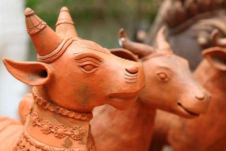 animal ritual: Cow clay sculpture.