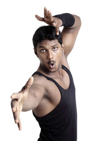 A muscular Indian man in casual clothing on white background  photo