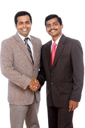 Two Indian business people shaking hands Stock Photo - 12225571