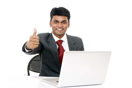 indian professional: Indian young businessman working in laptop isolated on white