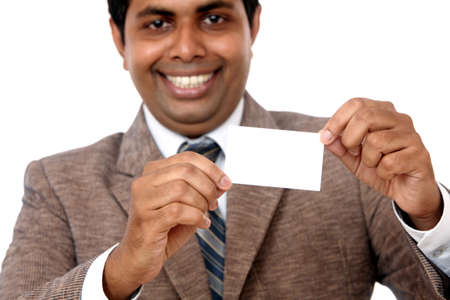 Business man handing a blank business card Isolated on white.  photo