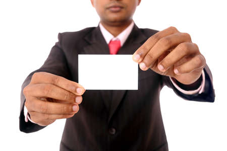 Business man handing a blank business card Isolated on white  photo