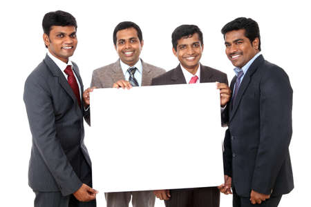 Group of Indian business people posing with white board photo