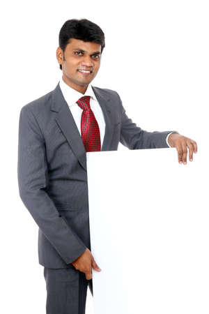 Confident Indian young businessman posing with white board  Stock Photo - 12225216