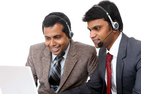 Indian young people working in call center isolated on white. Stock Photo - 12225544