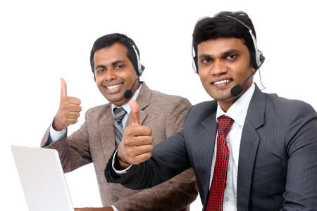 Indian young people working in call center isolated on white.  photo