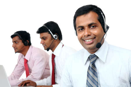 Indian young people working in call center isolated on white.  Stock Photo