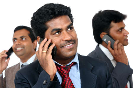Indian young business peoples talking in mobile phone. photo