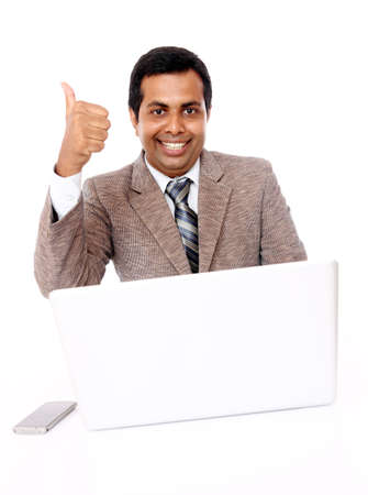 Indian young businessman posing with laptop isolated on white. Stock Photo - 12225171