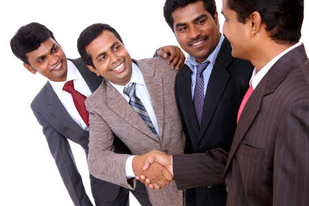 dedication: Indian business people shaking hands  Stock Photo