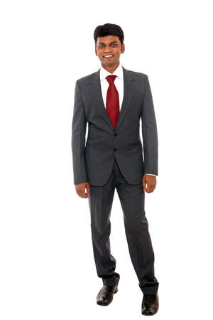 Indian business man posing to the camera on white background.  photo
