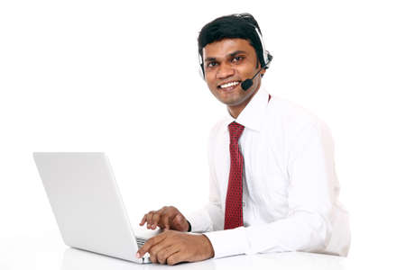 Indian young man working in call center isolated on white.  photo