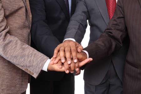 stacked hands, symbolizing team-effort  photo