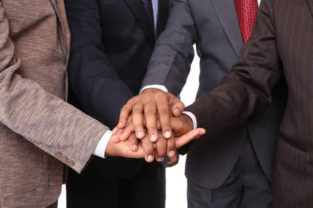 hands clasped: stacked hands, symbolizing team-effort  Stock Photo