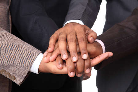strength in unity: stacked hands, symbolizing team-effort  Stock Photo