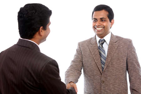 one to one meeting: Two Indian business people shaking hands  Stock Photo