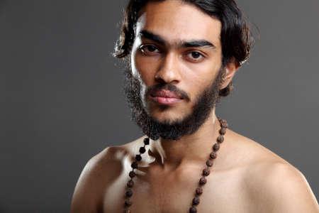 Indian young sadhu posing to the camera. Stock Photo - 12225466