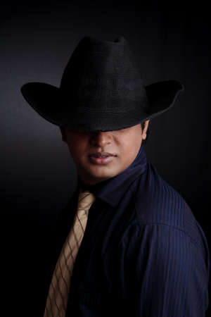 Portrait of an Indian business man over black background.  photo