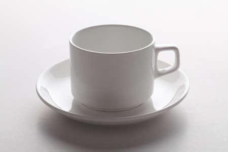 yellow tea pot: Tea cup on isolated on white.