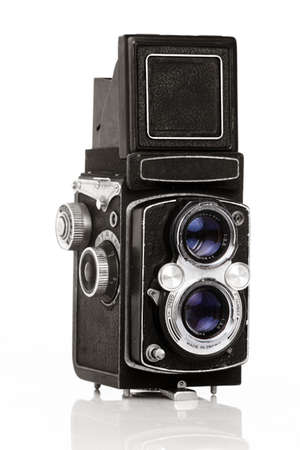 Twin lens reflex old photo camera isolated on white  photo