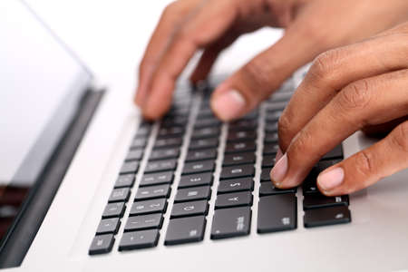 Hands on the laptop keyboard. Isolated on white background  Stock Photo - 12227299