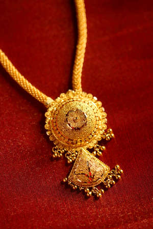 gold jewellery: Gold Necklaces on textured cloth background.  Stock Photo