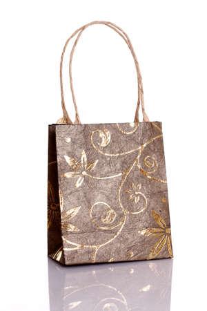 Decorated gift bag isolated on white background  photo