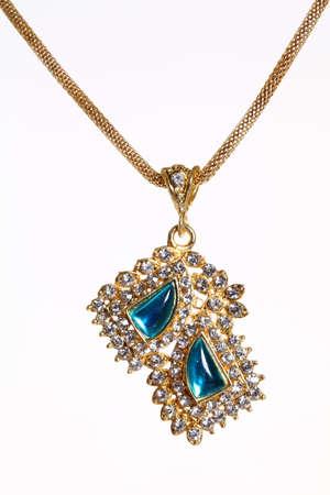 ruby gemstone: gold necklace isolated on white.  Stock Photo
