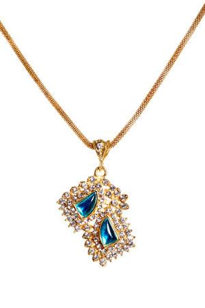 ladylike: gold necklace isolated on white.  Stock Photo