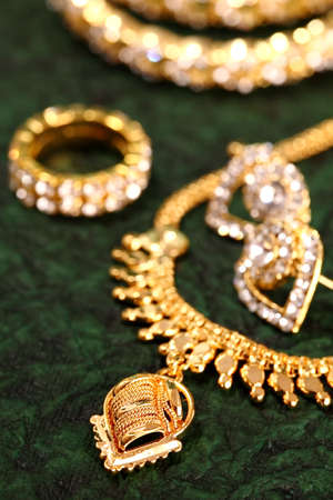 Gold ornaments on textured background.  photo