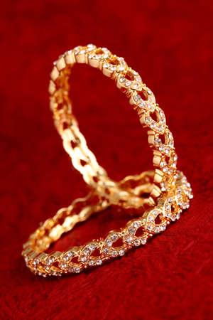 bangle: Gold bracelet on textured background.  Stock Photo