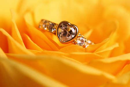 Diamond Ring on flower background.  photo