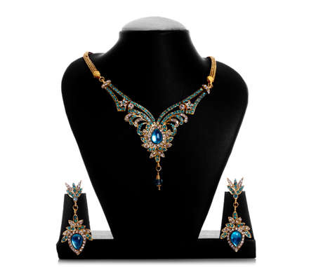 antique jewelry: Luxury golden necklace & earrings isolated on white.