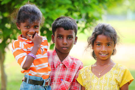 Group of one family childs looking at the camera.  photo