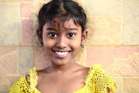 traditionally indian: Cute Indian teen girl looking to the camera   Stock Photo
